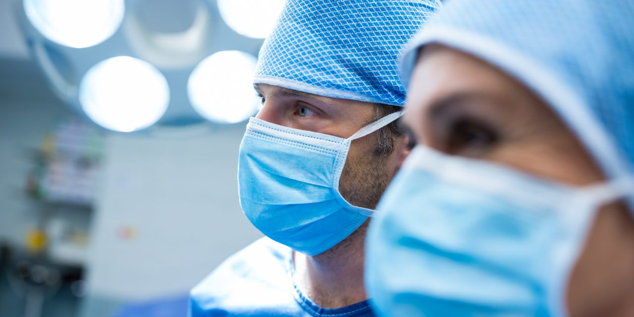 Surgeons standing in operation room at hospital